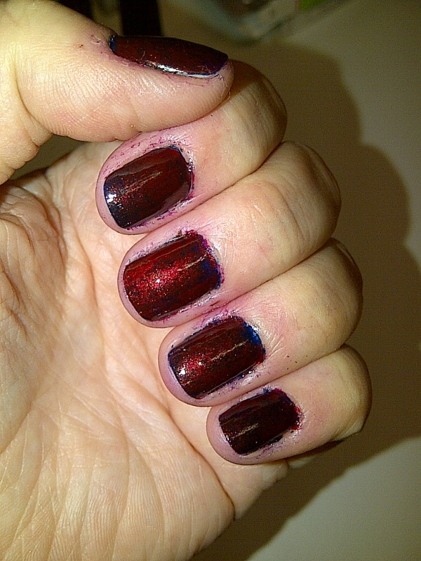 Step 4: once dry, clean the excess polish off your fingers apply your top coat.
