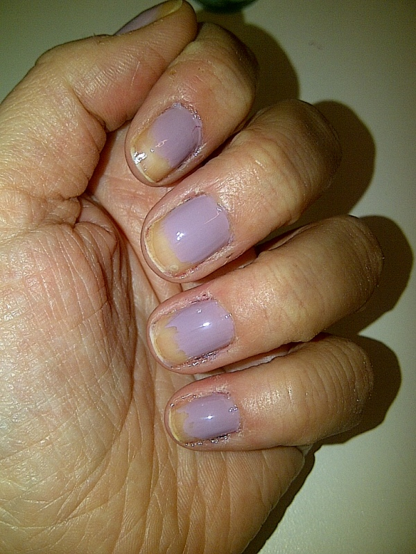 Step 2: apply two thin coats of your first colour two thirds of the way up your nails.