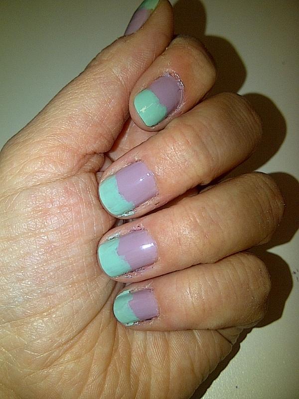 Step 3: apply two thin coats of your second colour to the top third of your nails and allow to dry.
