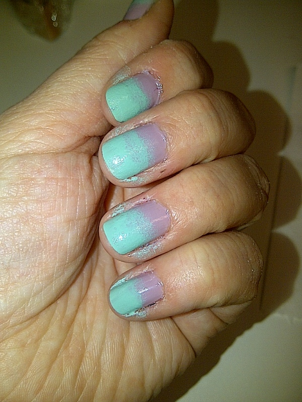 Step 5: dab the sponge across each nail where the two colours meet.