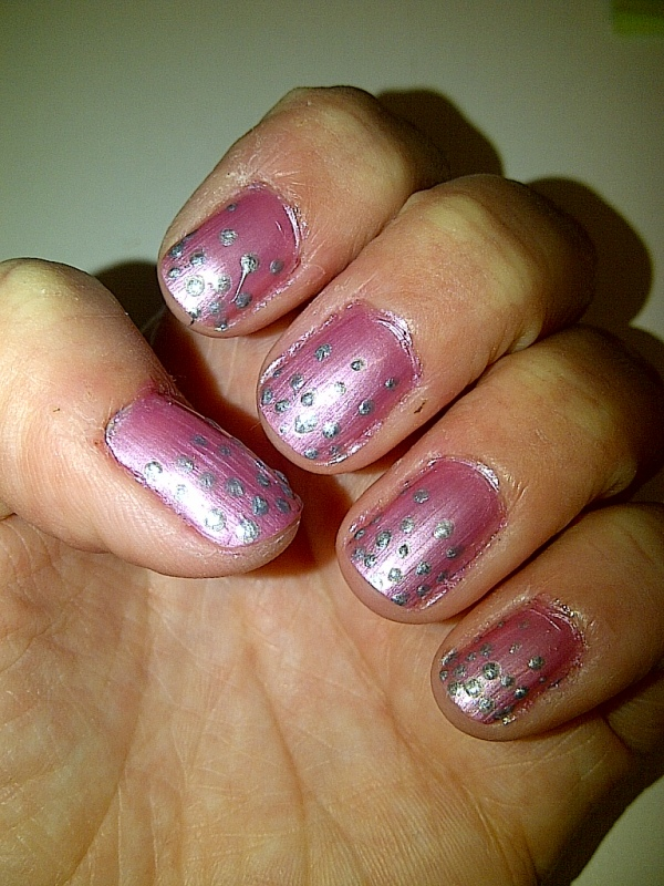 Step3: apply your silver dots, closer together at the top and spread out further down the nail.